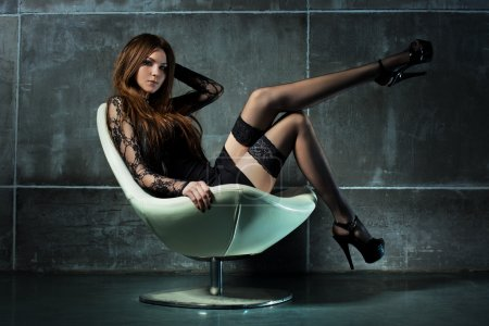 Photo for Young sexy woman on chair. - Royalty Free Image