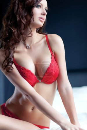 Photo for Young sexy woman in red lingerie portrait. - Royalty Free Image