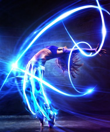 Photo for Young woman dancer. With light effects. - Royalty Free Image