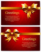 Beautiful red business cards with gold gift bows