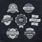 Vintage premium quality labels on blackboard background Set of retro styled badges Vector illustration