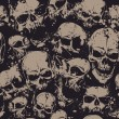 Grunge seamless pattern with skulls. Vector illustration.