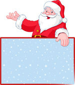 Santa Claus over blank greeting (place) card
