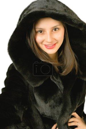 Photo pour Jeune fille dans un manteau de vison sur fond blanc. - image libre de droit
