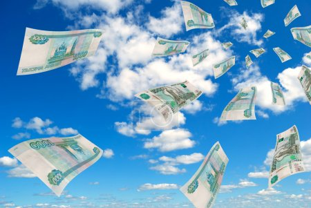 Russian banknotes deformed against the blue sky....