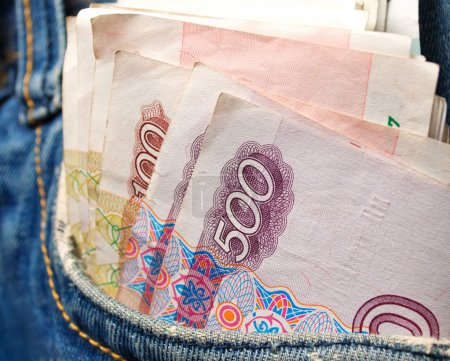 Cash Russian rubles in jeans pocket close-up....
