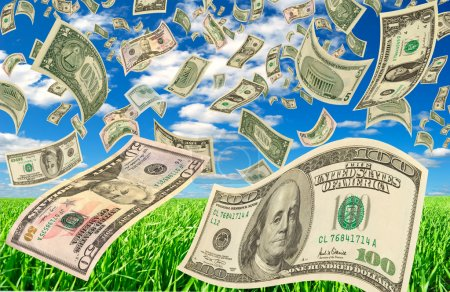 Dollars in various denominations on background of ...