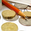 Still life with coins and bills pencil stock chart...