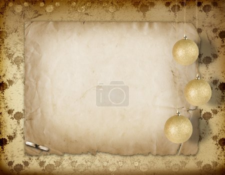 Christmas balls hanging on the old paper floral background