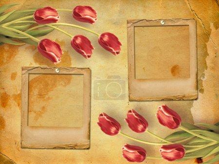 Photo pour Bouquet de tulipes rouges aux feuilles vertes sur fond de papier abstrait - image libre de droit