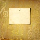 Grunge hudební pozadí s zlaté tóny