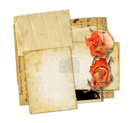 old photos and letters with bouquet