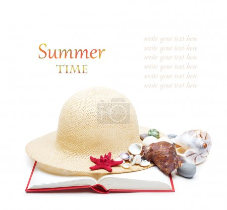 Straw hat with book and red starfish
