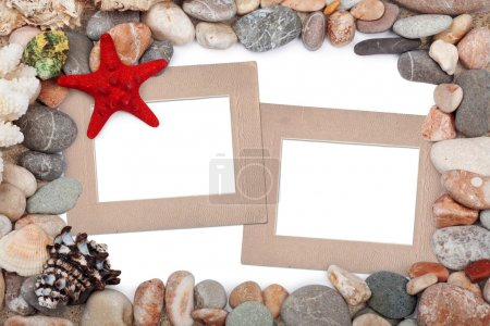 Paper Vintage photo frames with red starfish and pebbles