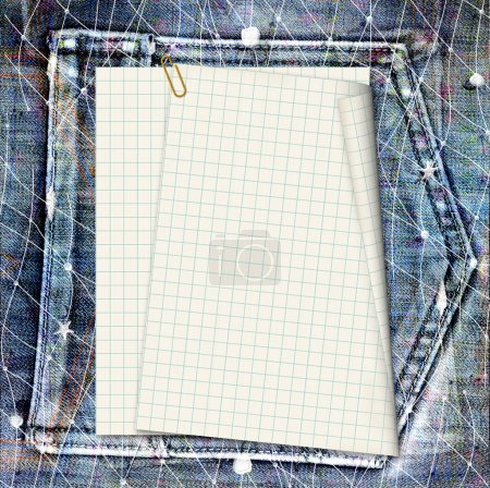 Old vintage sheet on shabby jeans background
