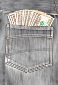 Dollar bills sticking in the back pocket
