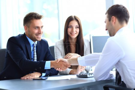 Businessman shaking hands to seal a deal with his partne