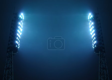 Photo for Stadium floodlights against a dark night sky background with copy space - Royalty Free Image