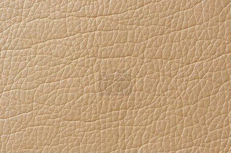 Photo pour Un coup de macro de texture beige simili cuir brillant - image libre de droit