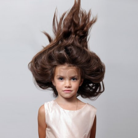 Young beautiful little girl with dark hair