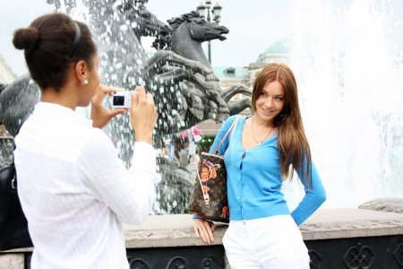 Two girls tourists are photographed