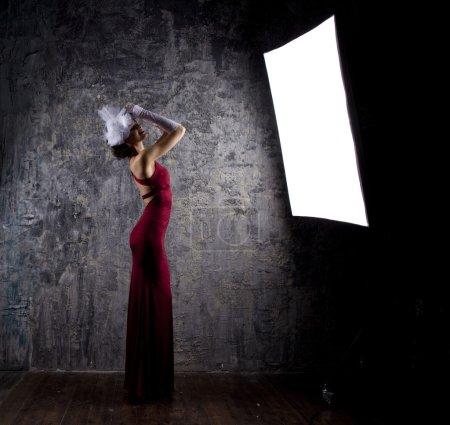Fashion model in long red dress