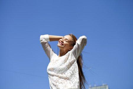 Upwards view of young woman enjoying life