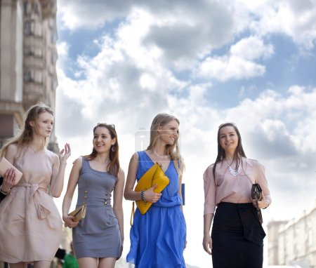 Photo for Four beautiful fashion women walking on the street in Moscow city - Royalty Free Image