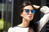 Business woman with blue mirrored sunglasses