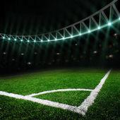 Fotbalové hřiště s jasnými světly