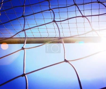 the soccer net with sun