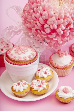 Still life of cupcakes with flower