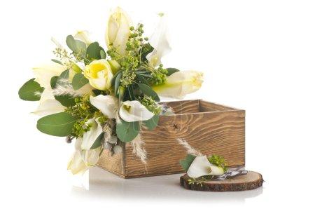 Foto de Bouquet in wooden box on white background - Imagen libre de derechos