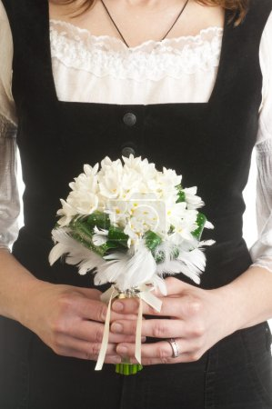 Photo for Bride holding wedding flower bouquet - Royalty Free Image