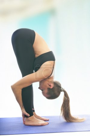 Woman in uttanasana pose