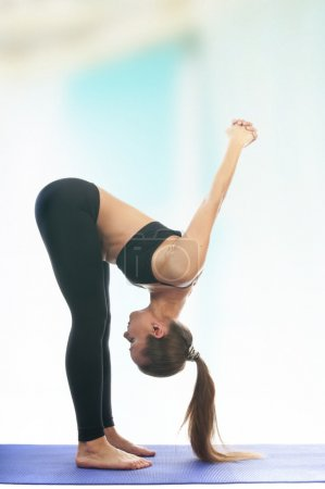 Woman in uttanasana pose, asana
