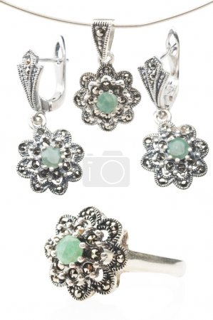 Silver collection with emerald gemstone