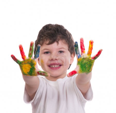 Boy with hands painted with colorful paint