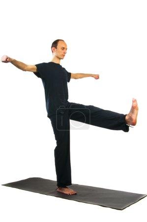 Man doing utthita hasta padasana position