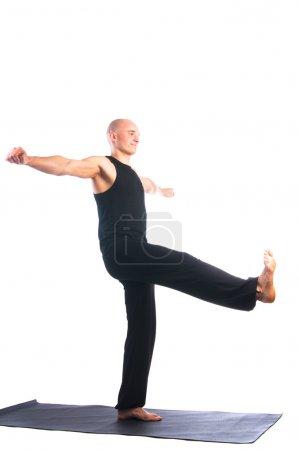 Man in Utthita hasta padasana pose