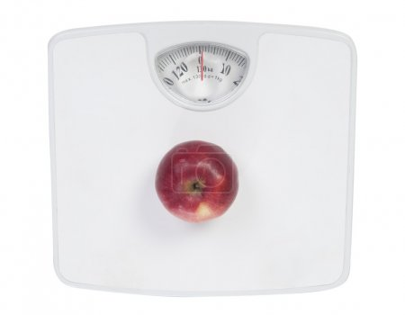 Red apple on the floor scales