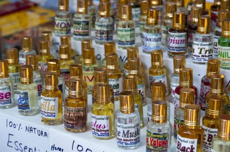 Photo for Bottles with homemade essential oil on the Indian market - Royalty Free Image