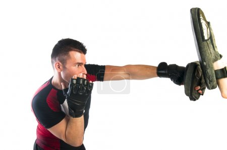 Man boxing in MMA gloves (grappling gloves)