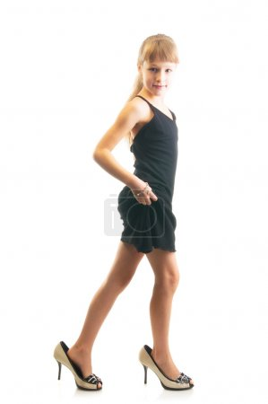 Girl in big shoes and black dress
