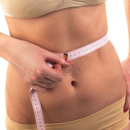 Woman measuring perfect waistline
