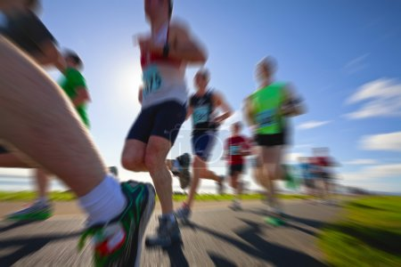 Photo for Marathon runners on the bank of ocean bay, blurred motion - Royalty Free Image