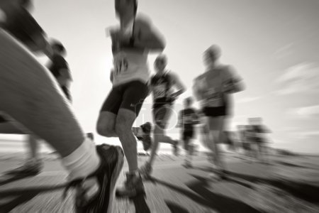 Photo for Marathon runners on the bank of ocean bay, blurred motion, Black&White - Royalty Free Image