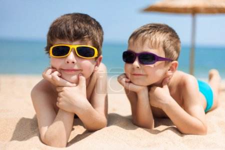 Photo for Portrait of two children on the beach - Royalty Free Image