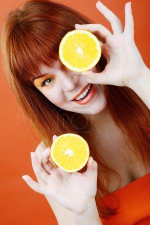 redhead girl with orange