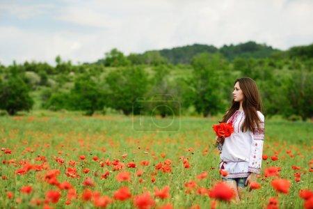 Ukrainian girl in poppy field